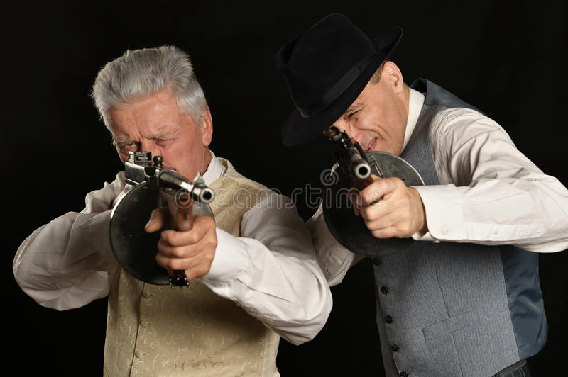 Handsome gangster men. In classic suit with weapon royalty free stock photography