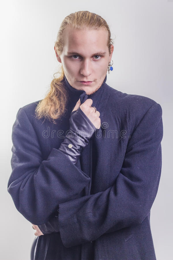 Handsome gothic blonde caucasian man portrait royalty free stock image
