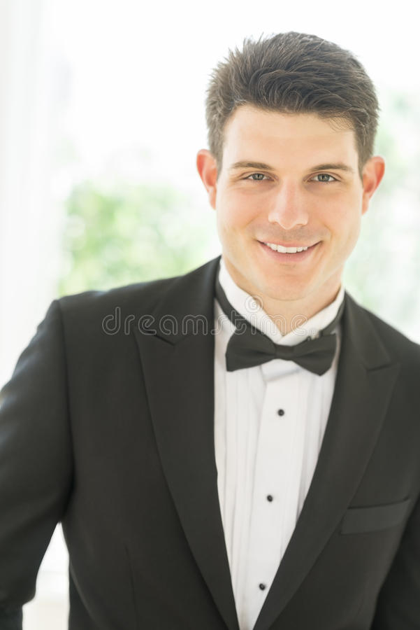 Handsome Groom In Tuxedo Smiling Royalty Free Stock Photo