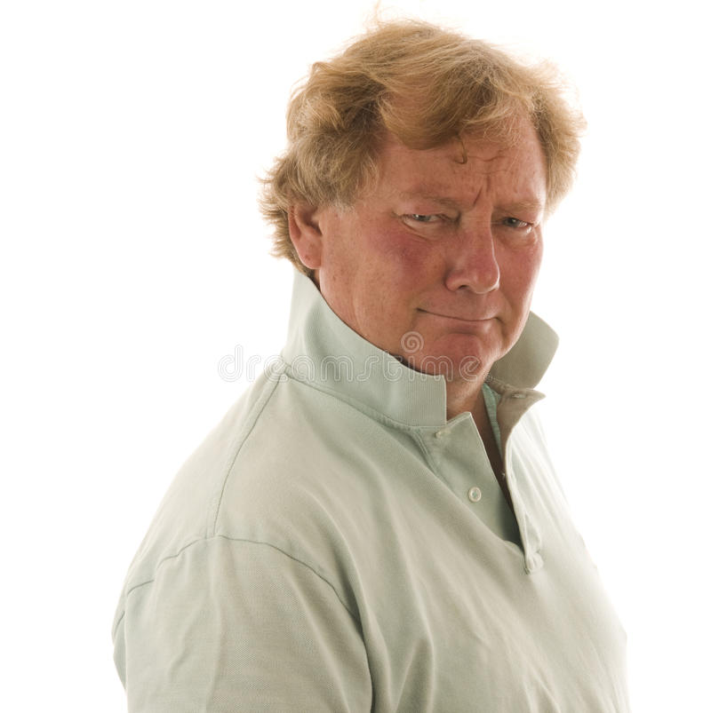 Handsome grumpy middle age man royalty free stock photography