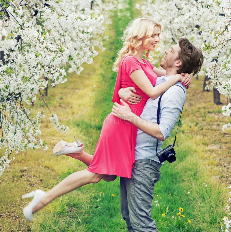 Handsome guy holding his adorable girlfriend royalty free stock photography