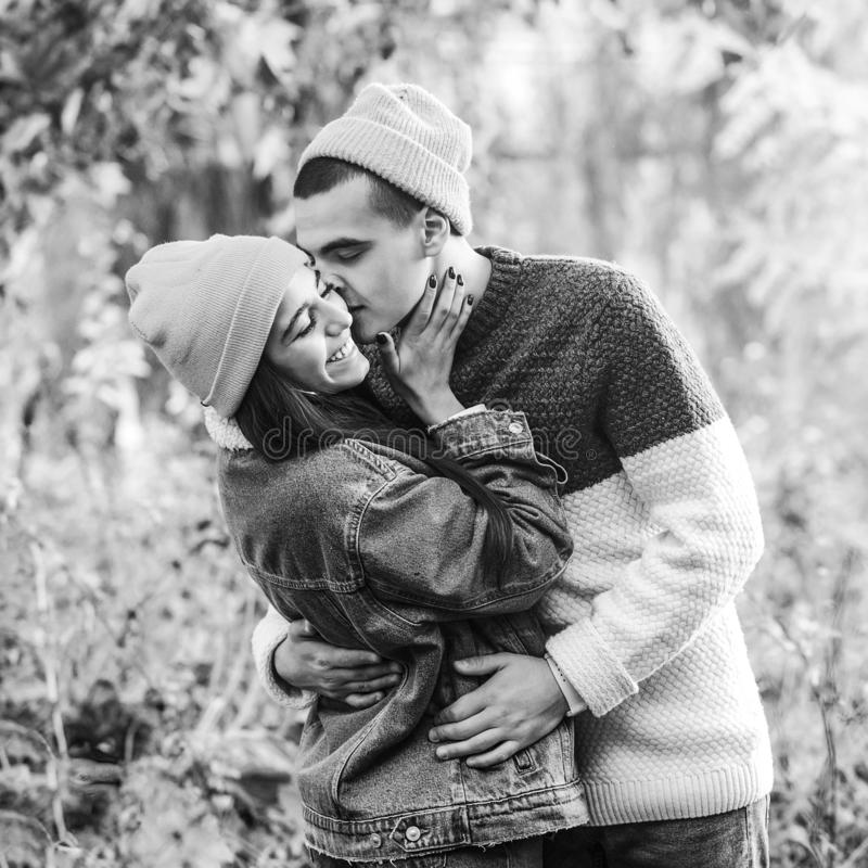 Handsome guy hugging and kissing his girlfriend. Valentine day. Lovely couple has a date at nature. Couple in love stock photo