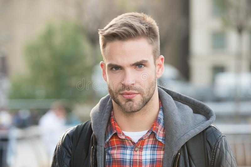 Handsome guy portrait. Facial hair and skin care concept. Handsome face. Masculine appearance. Handsome man unshaven stock photo