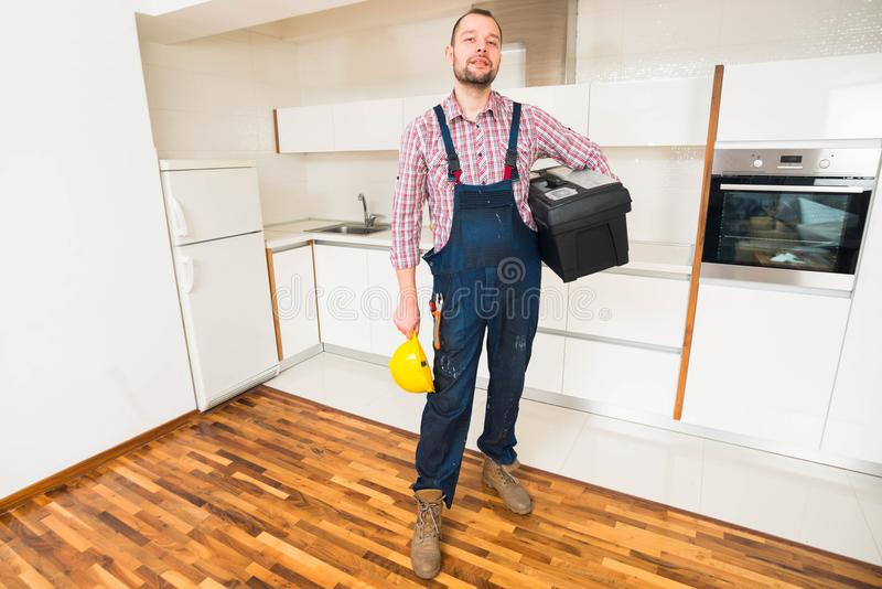 Handsome handyman with toolbox royalty free stock photography