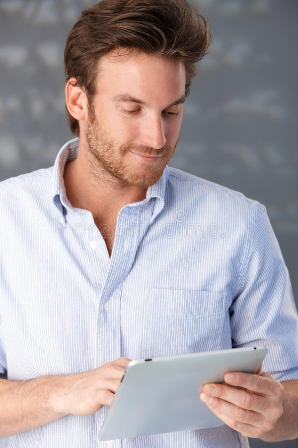Download Handsome Guy Using Touchscreen Computer Stock Photo - Image: 20750650