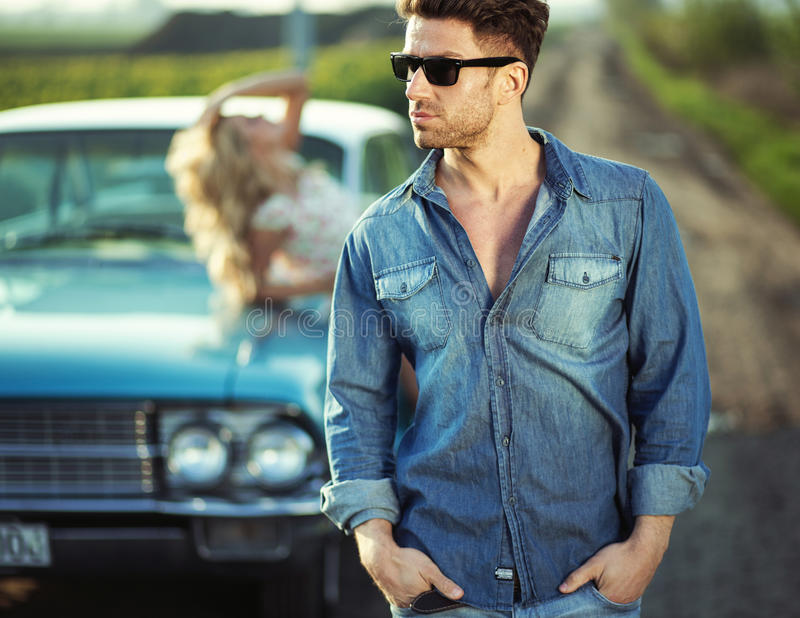 Handsome guy wearing trendy sunglasses. Handsome men wearing trendy sunglasses royalty free stock photography