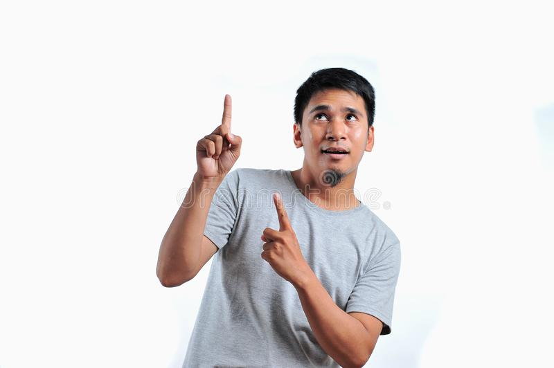 Handsome of happy smiling asian man pointing of a copyspace royalty free stock photos