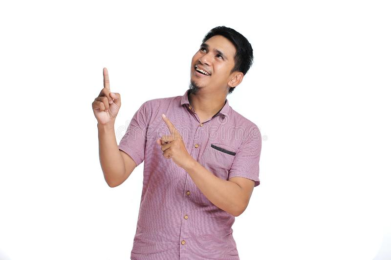 Handsome of happy smiling asian man pointing of a copyspace stock images