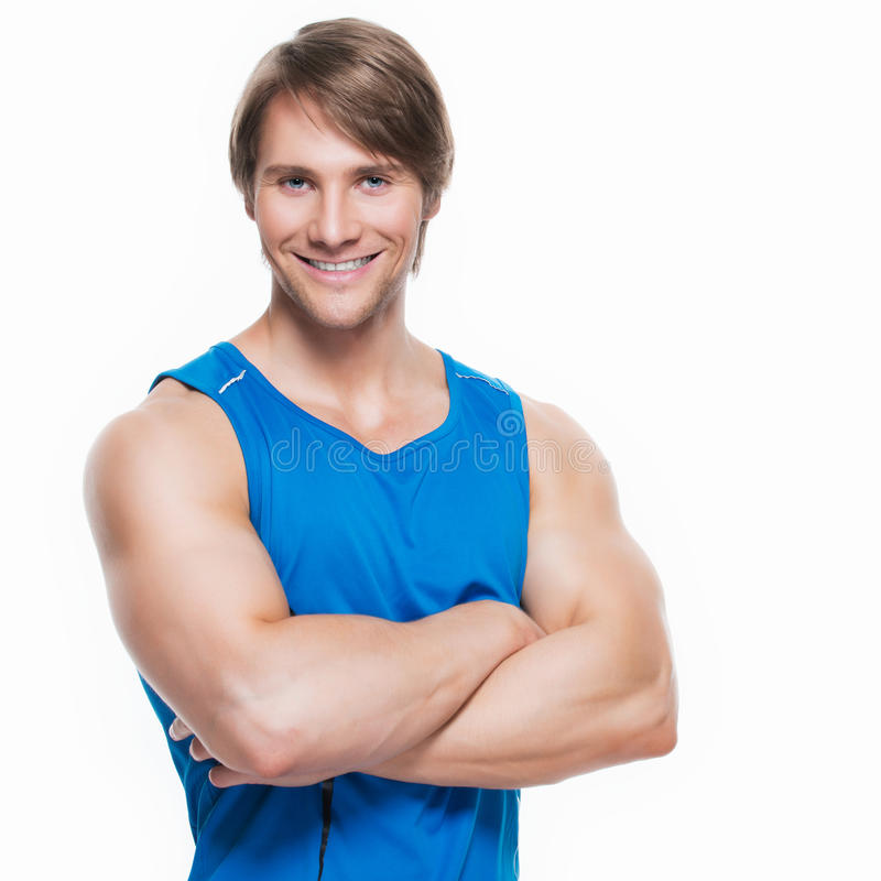 Handsome happy sportsman in blue shirt. stock photos
