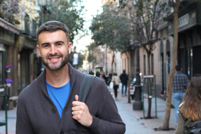 Handsome healthy man smiling in the city royalty free stock photo