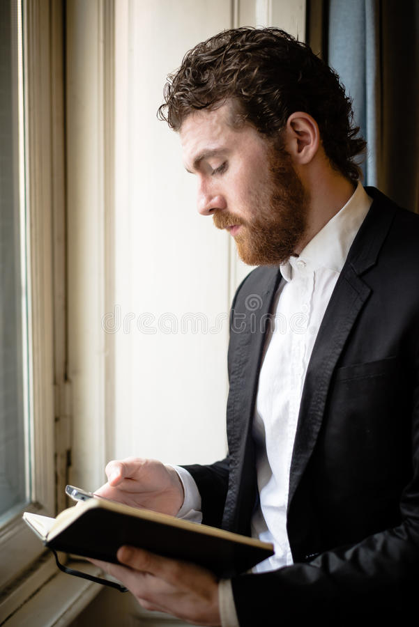 Handsome hipster elegant man on the cellphone royalty free stock image