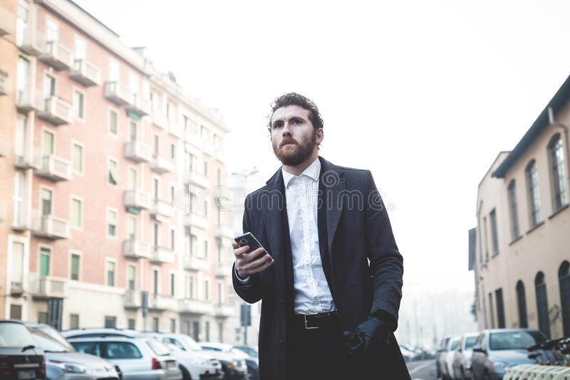 Handsome hipster elegant man in the city stock photo