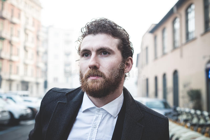 Handsome hipster elegant man in the city royalty free stock photography