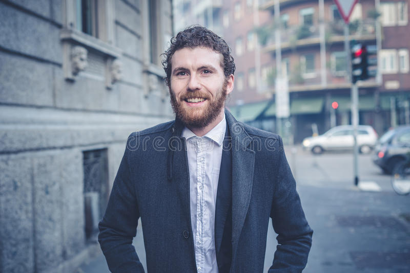 Handsome hipster elegant man in the city stock photos