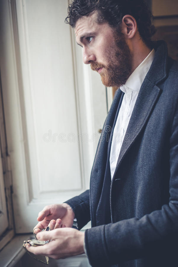 Handsome hipster elegant man with pocket watch royalty free stock photos
