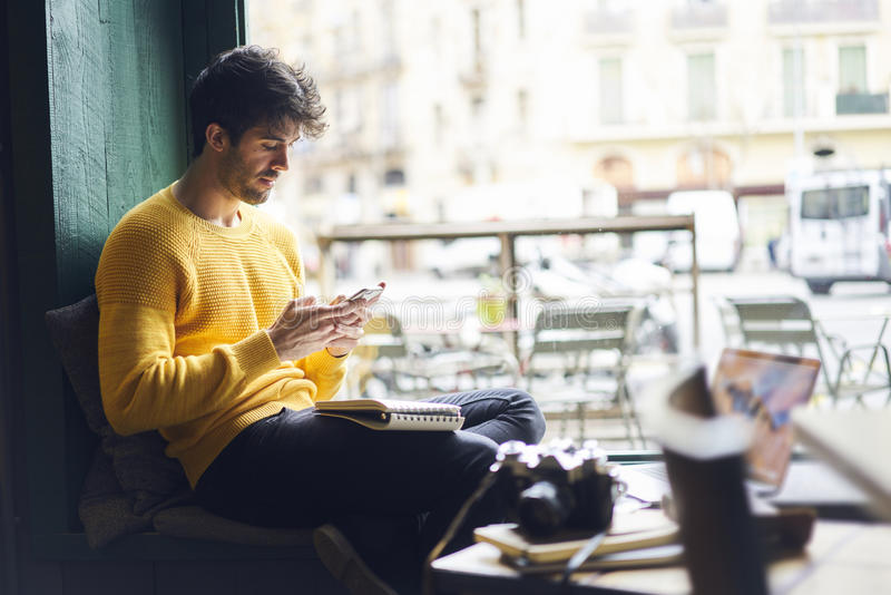 Handsome hipster man receive messages from friend royalty free stock photo