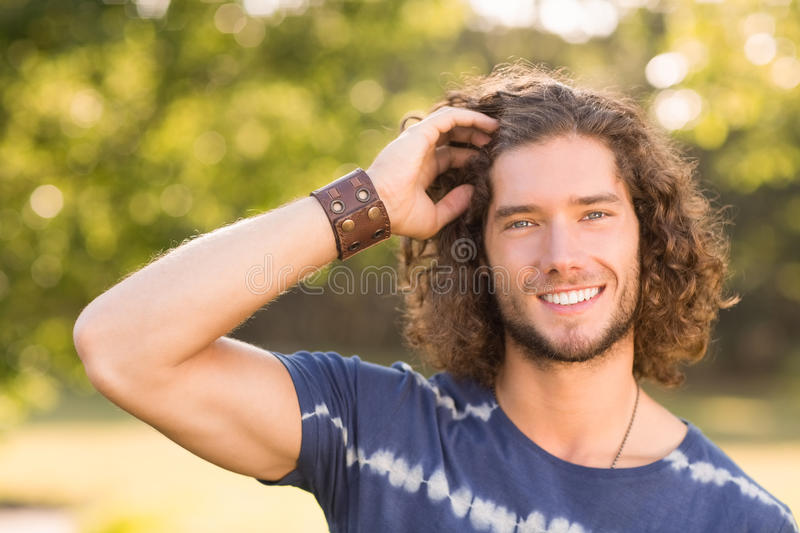 Handsome hipster in the park stock photo