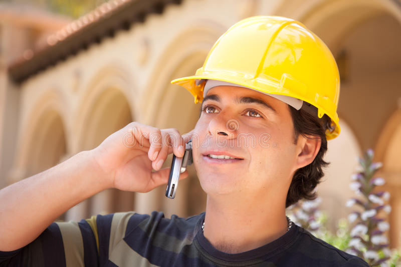 Handsome Hispanic Contractor with Hard Hat royalty free stock images