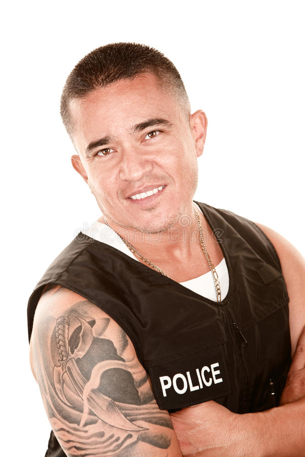 Download Handsome Hispanic Cop stock photo. Image of smile, necklace - 12433626