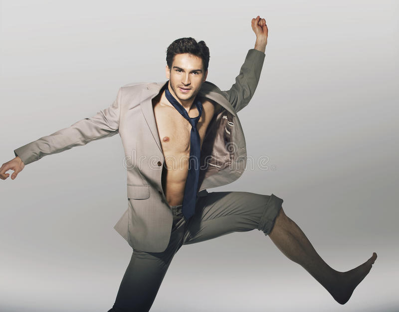 Download Handsome Jumping Guy With Funny Tie Stock Photo - Image: 30912434