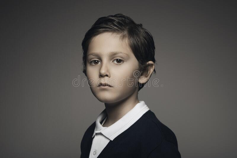 Handsome kid portrait looking at camera royalty free stock image