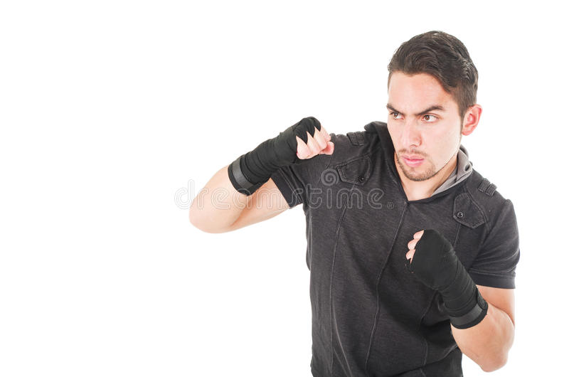 Handsome latin fighter wearing black clothes royalty free stock photos