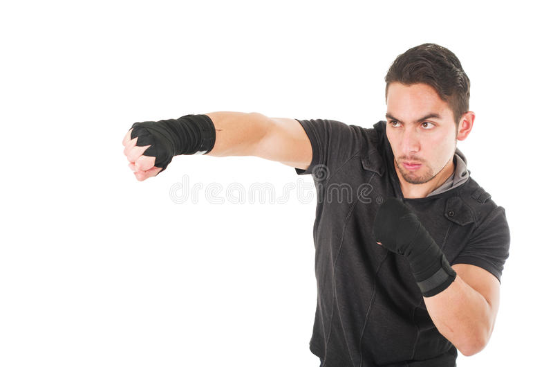 Handsome latin fighter wearing black clothes royalty free stock photography