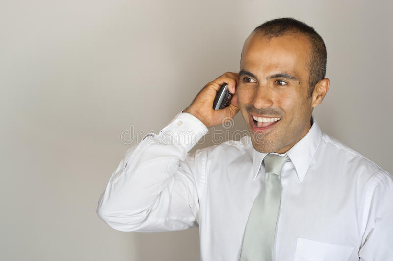 Download Handsome Latin Guy On Phone Stock Image - Image: 23291571