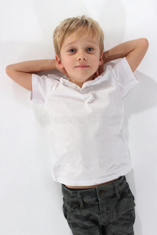 Handsome little boy with absolutely self confident attitude royalty free stock photo