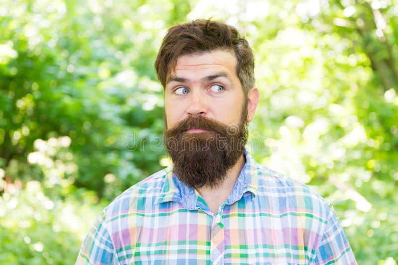 Handsome lumberjack. Man beard and mustache in summer forest. Summer vacation concept. Man bearded hipster green trees. Background. Hike and travel. Guy relax stock images
