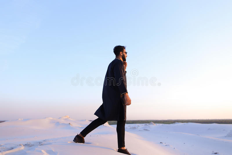 Handsome male Arab businessman talks on cellular business pro, s royalty free stock photography