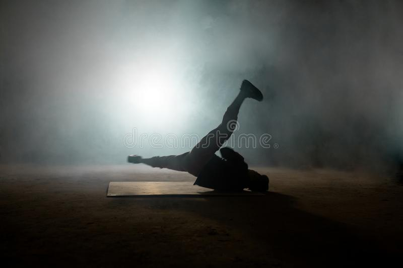 Handsome male dancer spinning on the back royalty free stock photos