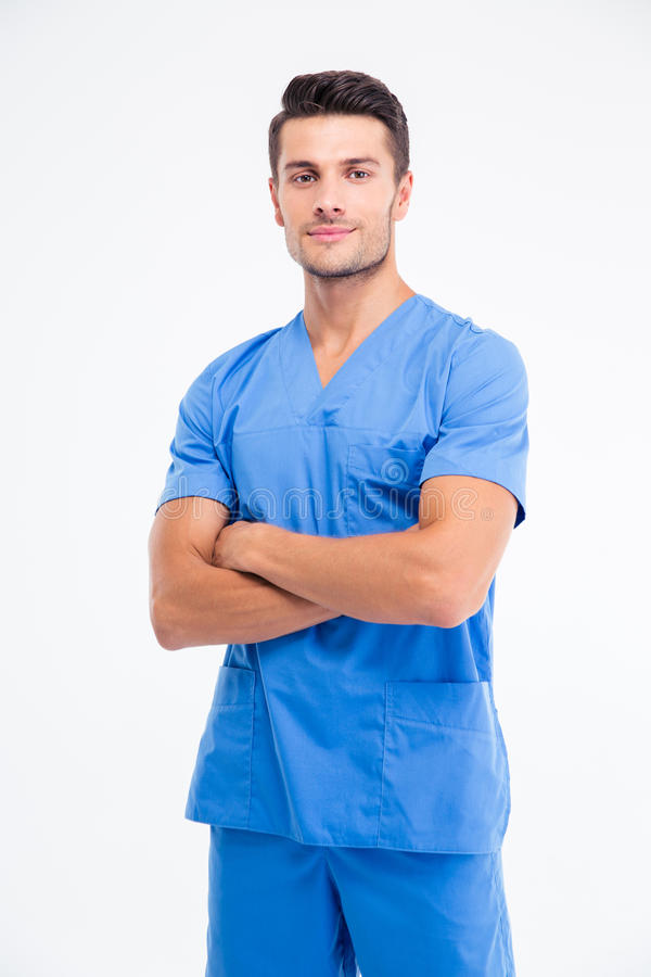 Handsome male doctor standing with arms folded stock images