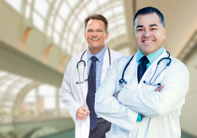 Handsome Male Doctors or Nurses Inside Hospital Building. Handsome Male Doctors or Nurses Standing Inside Hospital Building royalty free stock photos