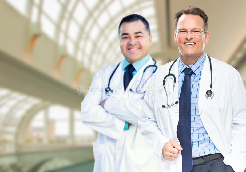 Handsome Male Doctors or Nurses Inside Hospital Building. Handsome Male Doctors or Nurses Standing Inside Hospital Building stock photos