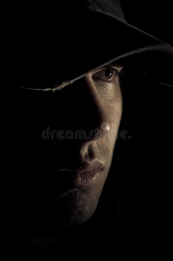 Handsome male with hat in profile. stock images