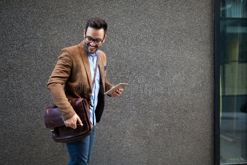 Handsome male marketing experts walking on city street going to visit meeting conference royalty free stock image
