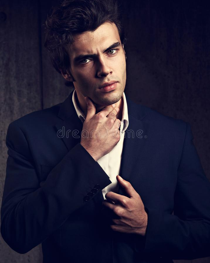 Handsome male model posing in fashion suit and white style shirt royalty free stock photo