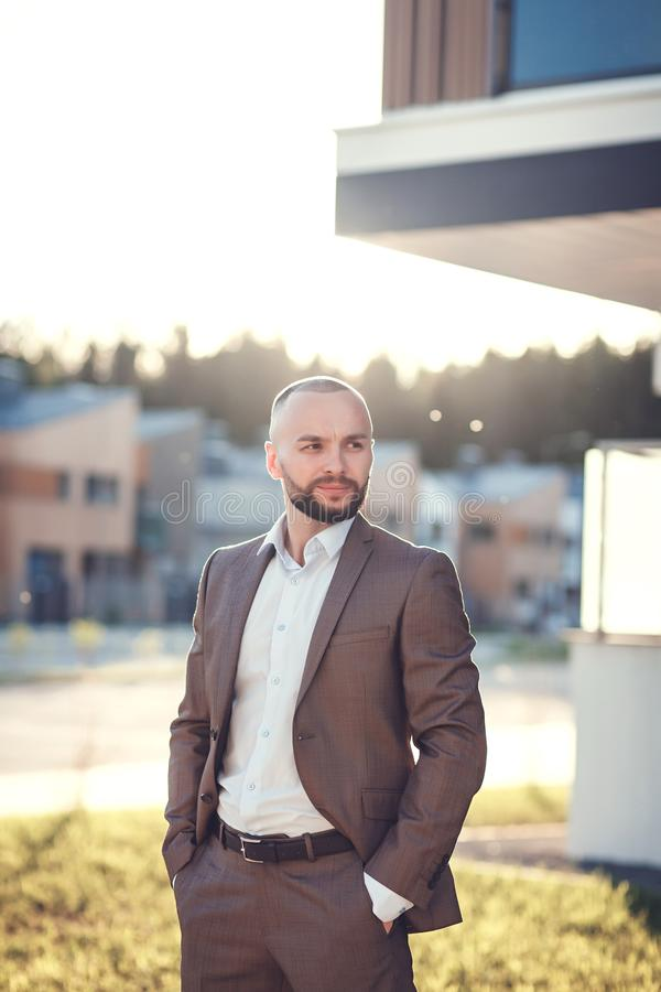 Handsome male model wearing a suit royalty free stock image
