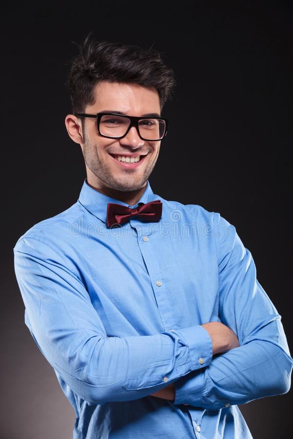 Handsome male standing with his arm crossed stock image
