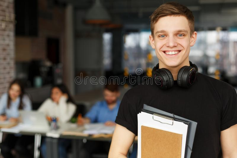 Handsome male student posing in campus library royalty free stock photos