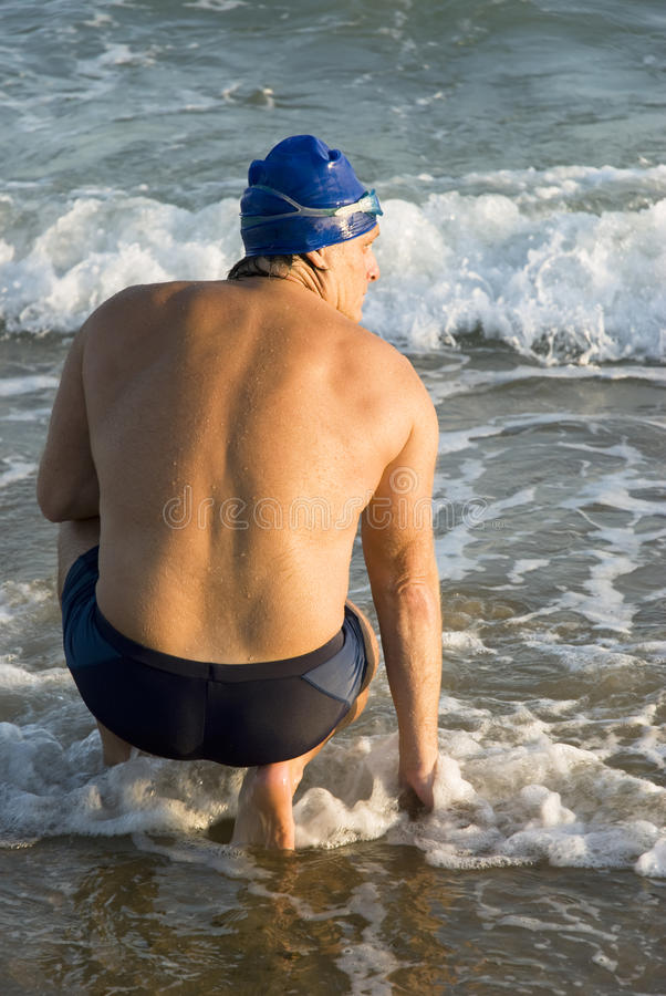 Handsome male swimmer. stock image