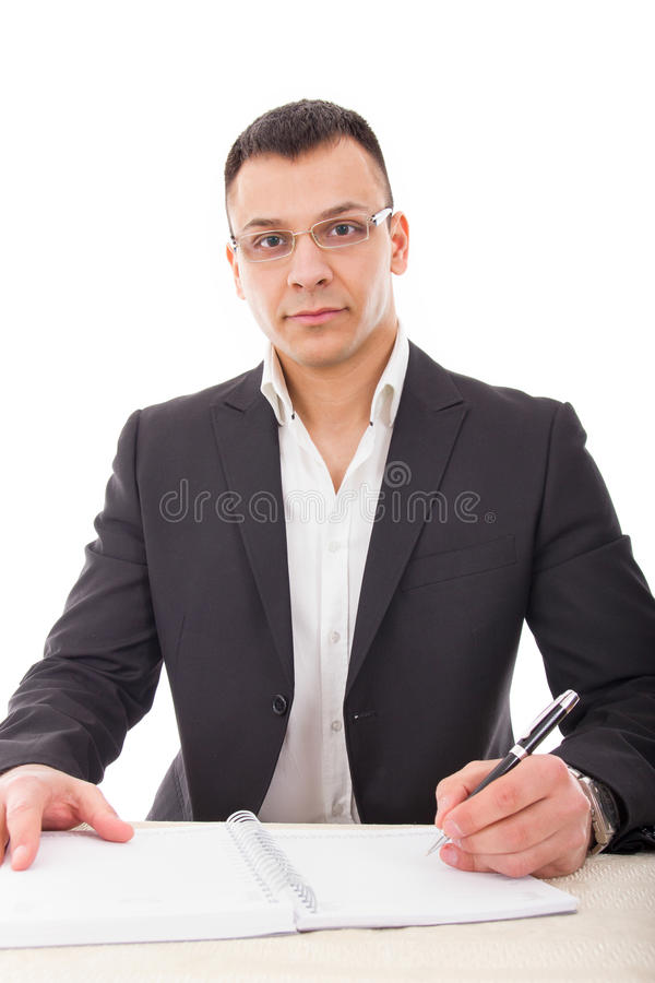 Handsome male teacher writing in notebook stock photos