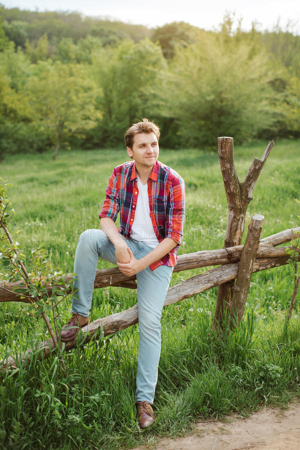 Handsome Man against green nature background stock image