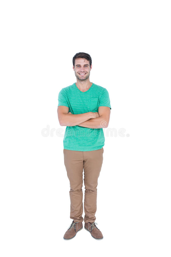 Handsome man with arms crossed looking at camera. On white background royalty free stock photos