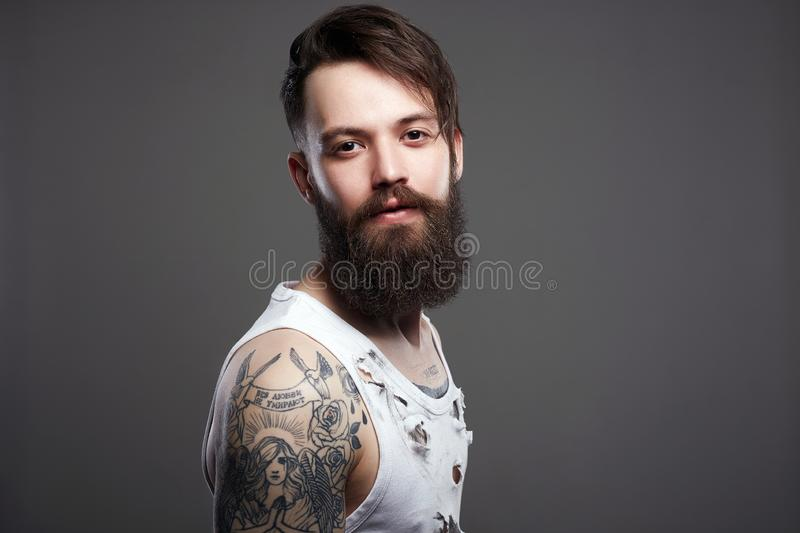 Bearded hipster. Boy with stylish haircut and tattoo. Handsome man with beard. bearded hipster. Boy with stylish haircut and tattoo stock photos
