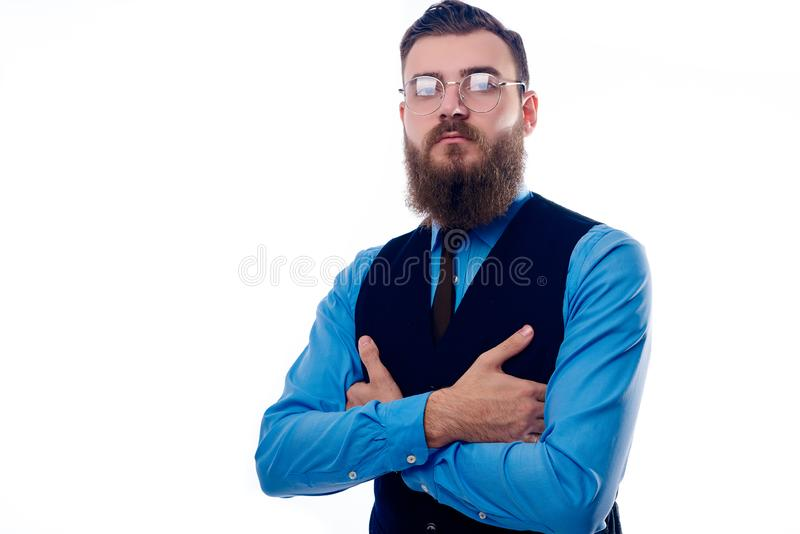 Handsome man with a beard dressed in a blue shirt royalty free stock photo