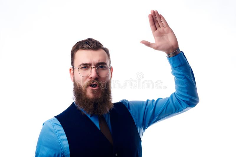 Handsome man with a beard dressed in a blue shirt royalty free stock photos