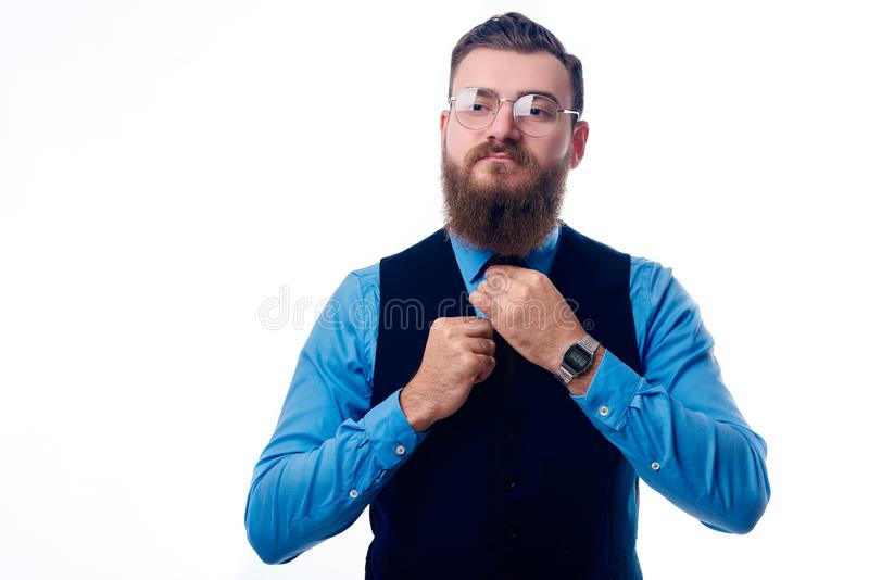 Handsome man with a beard dressed in a blue shirt stock image
