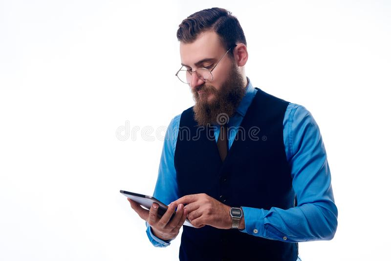 A handsome man with a beard dressed in a blue shirt royalty free stock photography